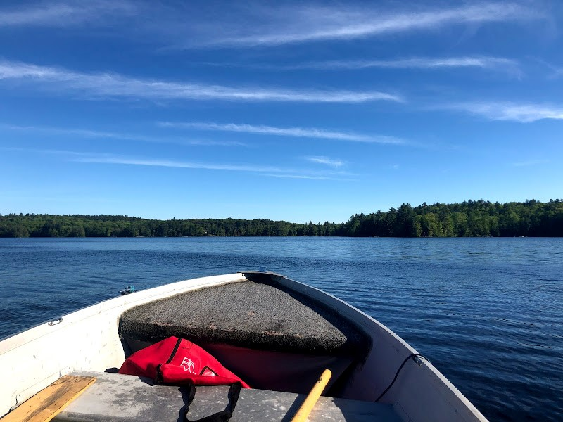 Boating on a lake with blue skies